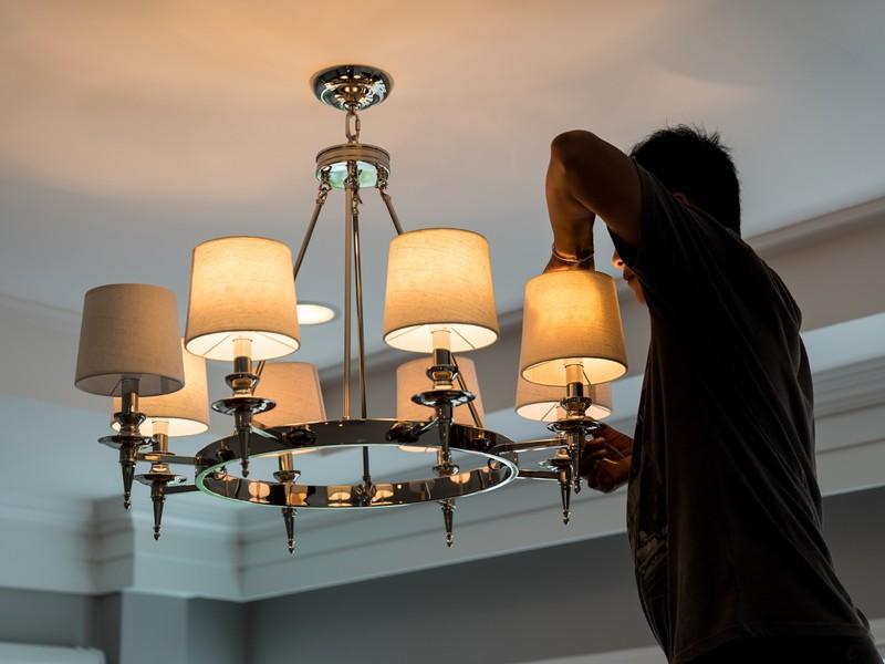 A professional installs lighting